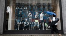Lululemon bucks the weak holiday sales trend and raises guidance