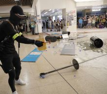 The Latest: Hong Kong protesters trample Chinese flag