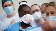 Drained by COVID fight, some French ICU nurses strike for better pay