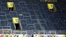 Bundesliga clubs, led by Borussia Dortmund, grumble as games go back behind closed doors