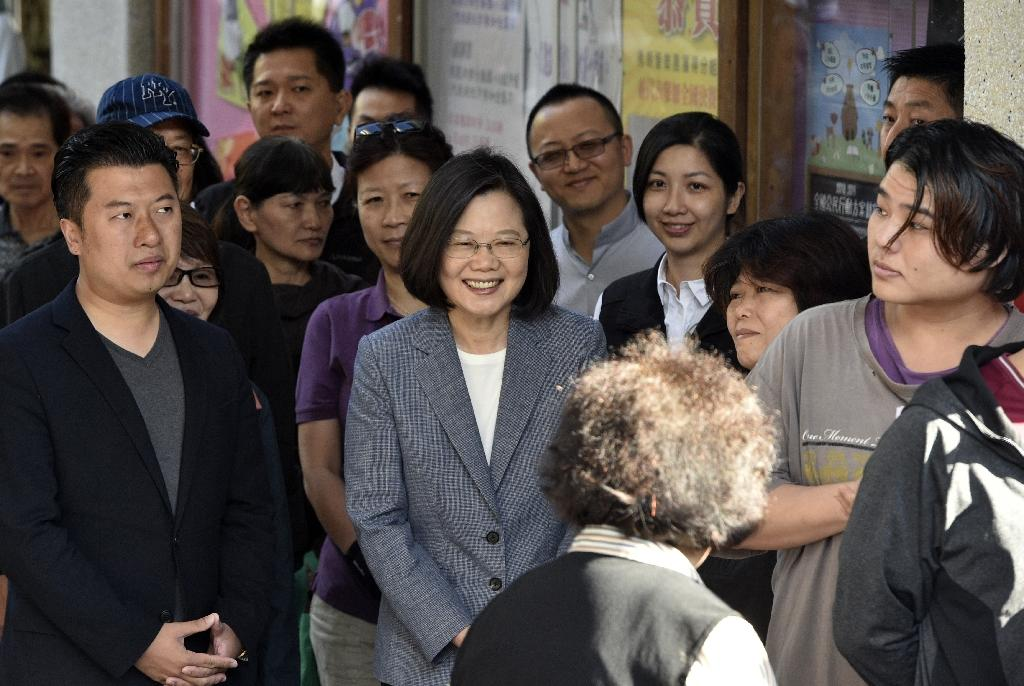 China has blamed the 'separatist stance' of Taiwan's President Tsai Ing-wen for her party's massive electoral losses (AFP Photo/SAM YEH)