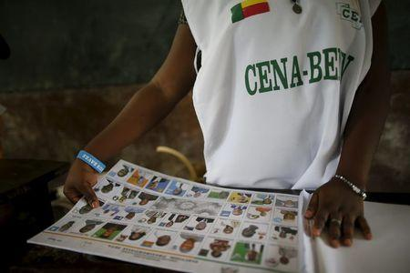 An electoral officer prepares voting materials during a presidential election at a polling station in Cotonou, Benin, March 6, 2016. REUTERS/Akintunde Akinleye