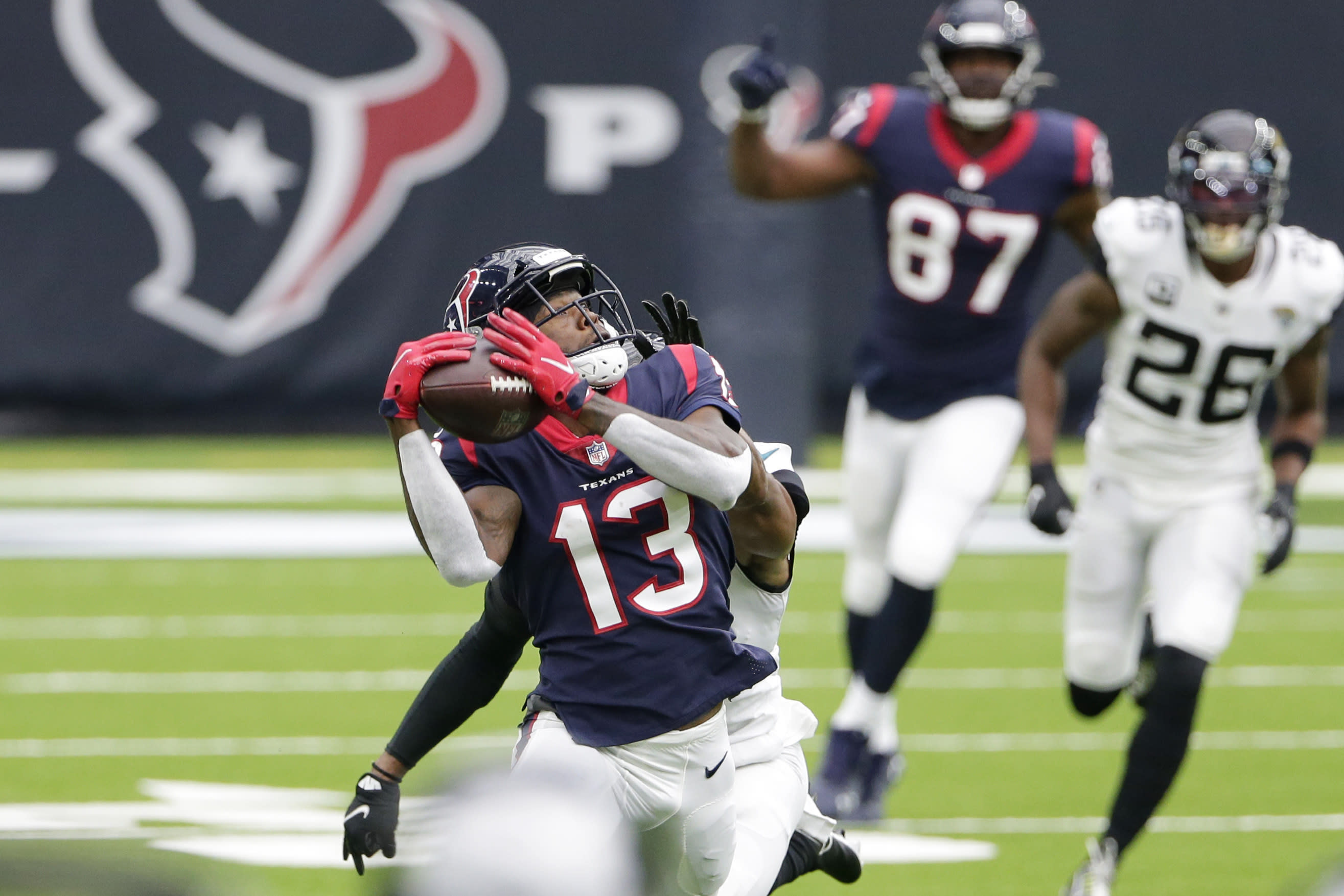 Houston Texans wide receiver Brandin Cooks (13) makes a catch against the Jacksonville Jaguars during the first half of an NFL football game Sunday, Oct. 11, 2020, in Houston. (AP Photo/Michael Wyke)