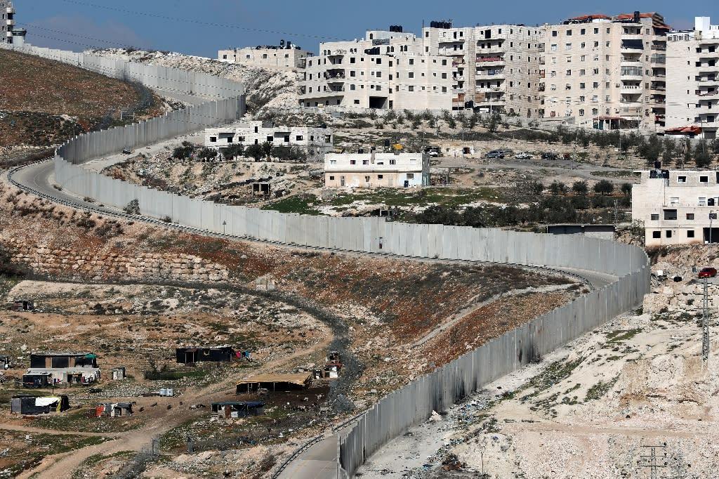 Israel's separation barrier dividing east Jerusalem (L) from the West Bank village of Anata
