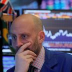 Wall Street tumbles as weak industrial forecasts add to sour mood