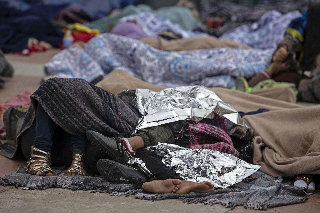 """Central American migrants travelling in the """"Migrant Via Crucis"""" caravan sleep outside """"El Chaparral"""" port of entry to US while waiting to be received by US authorities, in Tijuana, Baja California State, Mexico on April 30, 2018 According to the U.S. Customs and Border Protection on Sunday, none of the migrants from the caravan was processed for asylum because the agency had reached capacity for the day for migrants seeking asylum. At least 150 Central American migrants reached the border between Mexico and the United States on Sunday, determined to seek asylum from the US. The group arrived in the Mexican border town of Tijuana, part of a caravan of more than 1,000 people who set out from Mexico's southern border on March 25"""