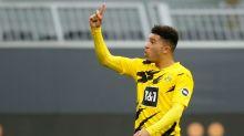 Soccer-Man United complete Sancho signing from Dortmund