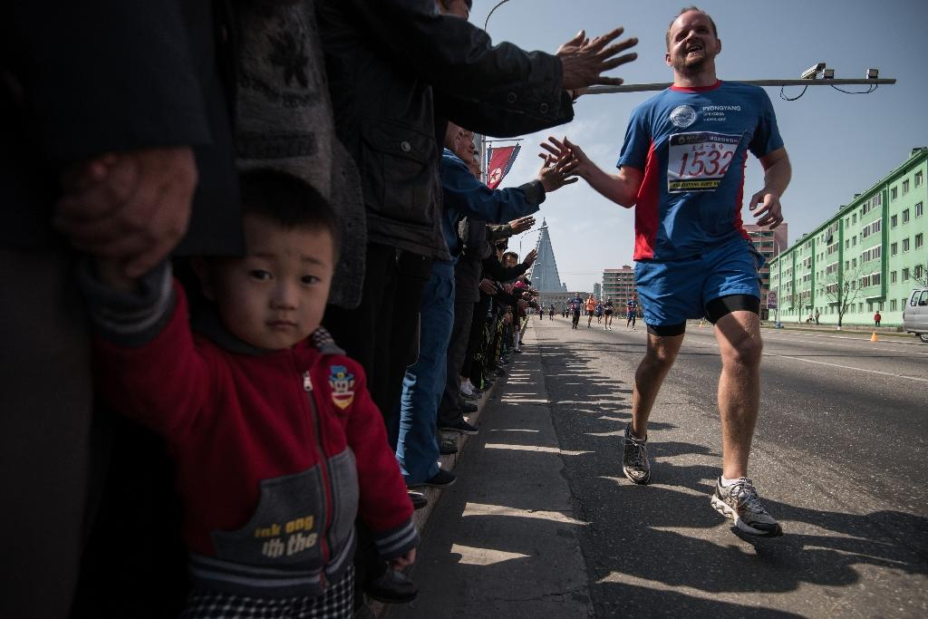 Hundreds of foreigners lined up in Pyongyang's Kim Il-Sung Stadium for the city's annual marathon, the highlight of the isolated country's annual tourism calendar (AFP Photo/Ed JONES)