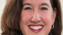 AT&T's Kate Hopkins is playing a key role in corralling 'reams of data' in new ways