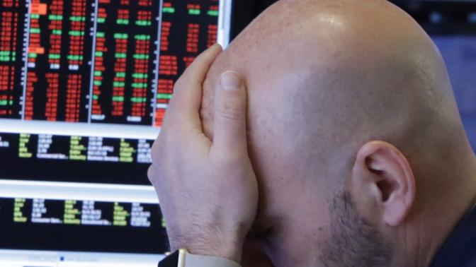 Stocks plummet on trade war fears, Dow off 700
