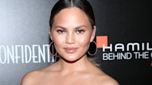 Chrissy Teigen shared a photo from her breast implant removal surgery after saying nobody believes she had them taken out