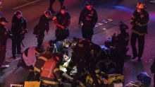 1 of 2 protesters hit by car on closed Seattle highway dies