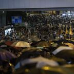 Hong Kong Protest Tactics Shift With Peaceful Mass March in Rain