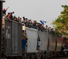 Migrant caravan on the 'Beast' train to avoid Mexican police raids and make it to U.S. border