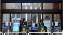 China orders 'unprecedented' lockdown of two cities at virus epicenter