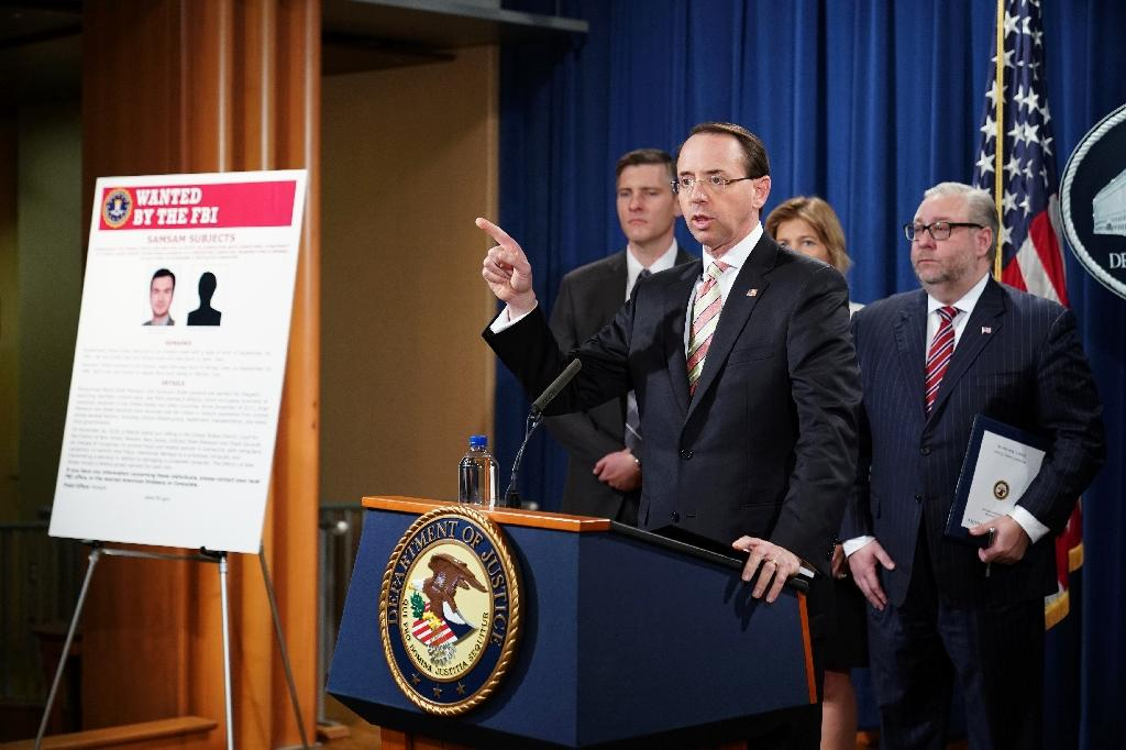 US Deputy Attorney General Rod Rosenstein announces the indictment of two Iranians allegedly behind the SamSam ransomware that was used to extort hospitals, city governments and other institutions in the United States and Canada