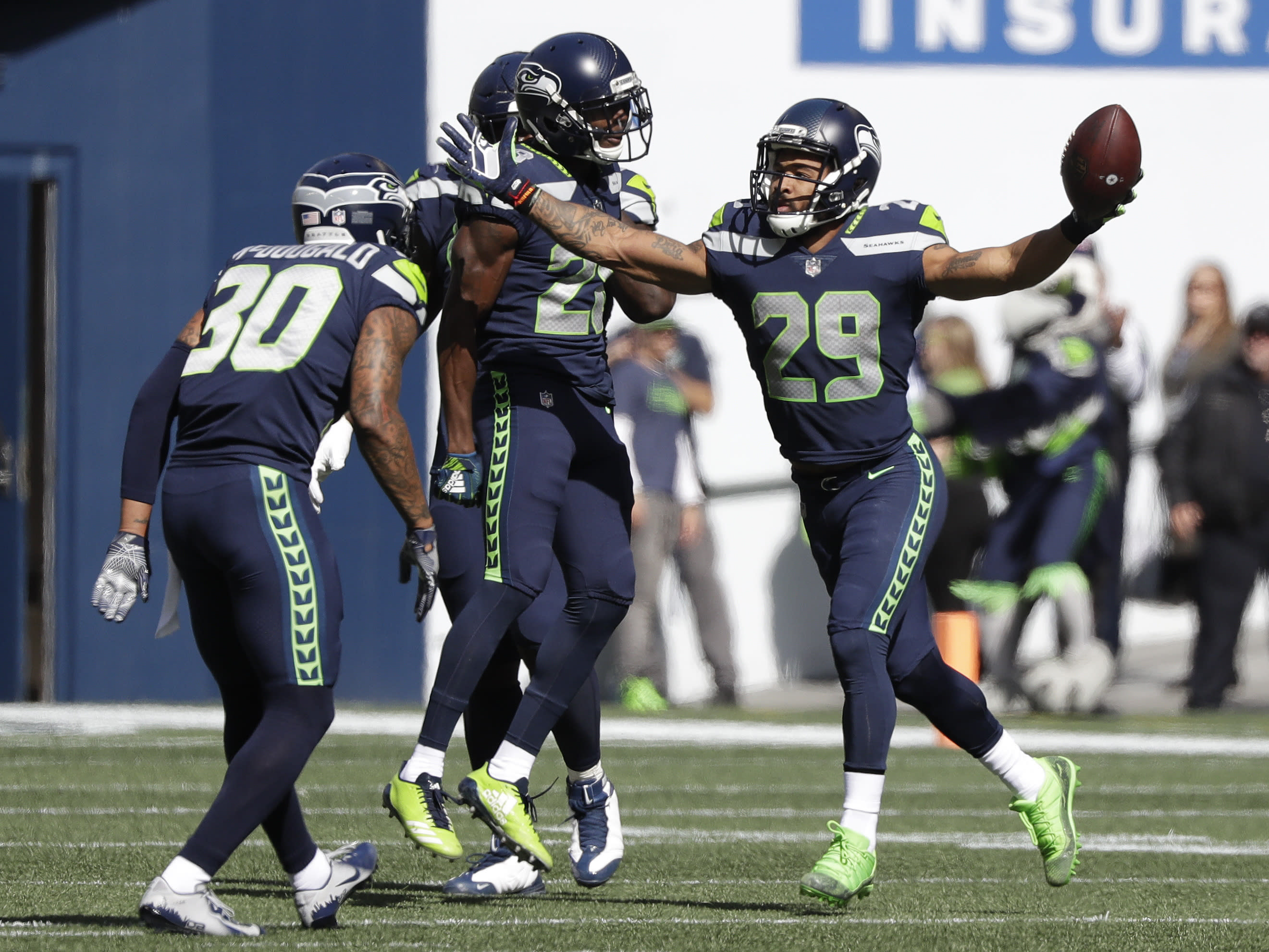 Seattle Seahawks free safety Earl Thomas (29) celebrates after he intercepted a pass during the first half of an NFL football game against the Dallas Cowboys, Sunday, Sept. 23, 2018, in Seattle. (AP Photo/Elaine Thompson)
