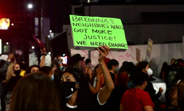 Critics -- including these protesters in Los Angeles on September 24, 2020 -- have decried the grand jury's decision to charge a police officer for endangering neighbors, but not for killing Breonna Taylor