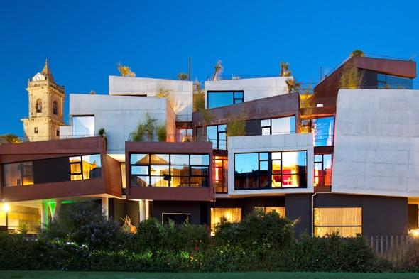 """<p> Hotel Viura in Spain's wine-rich Rioja region is architecturally flamboyant and set against the backdrop of a traditional Spanish village. The striking bolthole, designed by owner-architects Joseba and Xabier Aramburu, has 33 cubed rooms piled nonchalantly on top of each other, with superb views of the village, mountains and a 17th-century church. The avant-garde hotel is a work of art and was designed to resemble a bunch of grapes. If you're an architecture buff, you'll want to visit the Ysios winery nearby, which was designed by Spanish artist Santiago Calatrava and offers contemporary design as well as fabulous wine. Visit <a href=""""http://www.hotelviura.com/"""" target=""""_blank"""">hotelviura.com</a></p>"""