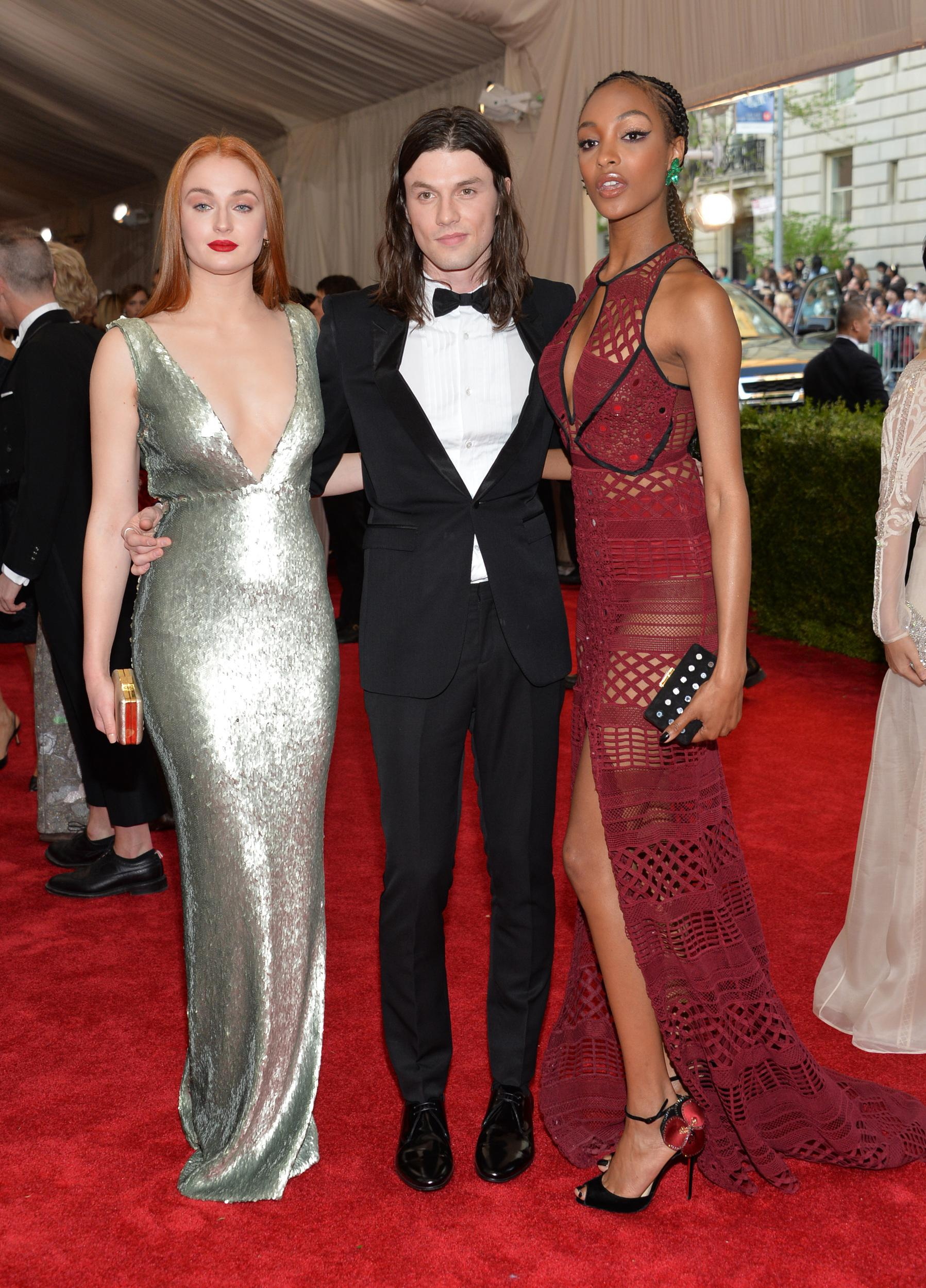 """Sophie Turner, from left, James Bay and Jourdan Dunn arrive at The Metropolitan Museum of Art's Costume Institute benefit gala celebrating """"China: Through the Looking Glass"""" on Monday, May 4, 2015, in New York. (Photo by Evan Agostini/Invision/AP)"""