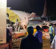 Kerala plane crash: 18 dead after Air India plane breaks in two at Calicut