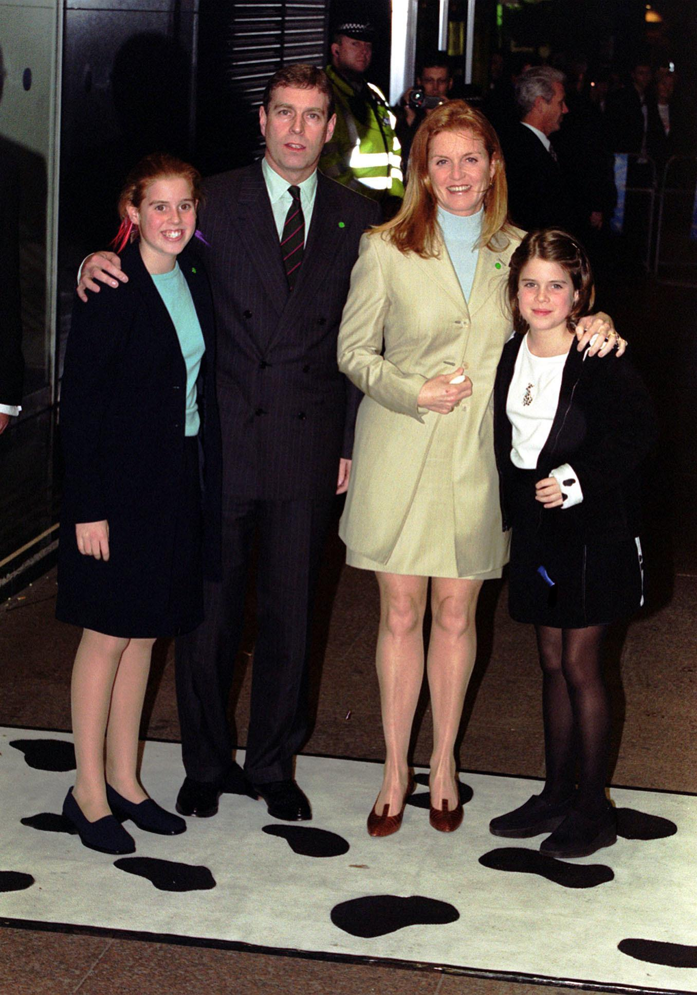 """The Duke and Duchess of York, with their two daughters Beatrice (L) and Eugenie, arriving for the European Premiere of """"102 Dalmations"""" at the Odeon cinema, in Leicester Square, London."""
