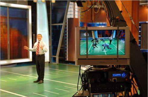 New tech puts ESPN anchors on video game gridiron
