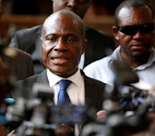 Congo opposition leader declares himself president as court upholds election result