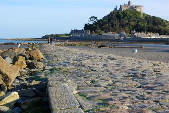 "<p>Follow in giants' footsteps along <a href=""http://www.southwestcoastpath.com/walksdb/71/"" target=""_blank"">Mount's Bay</a> in Cornwall, where you can enjoy an easy walk from Penzance along surfaced paths suitable for pushchair and mobility aids, as well as great views across the bay and out towards the Lizard and Mousehole. At low tide, take a ten-minute stroll across the causeway from Marazion to St Michael's Mount, which according to legend was home to a giant who was lured to his death by a brave local boy. Children will love hunting for the giant's stone heart etched in the pathway. <strong>Best for: Fun with the kids.</strong></p>"