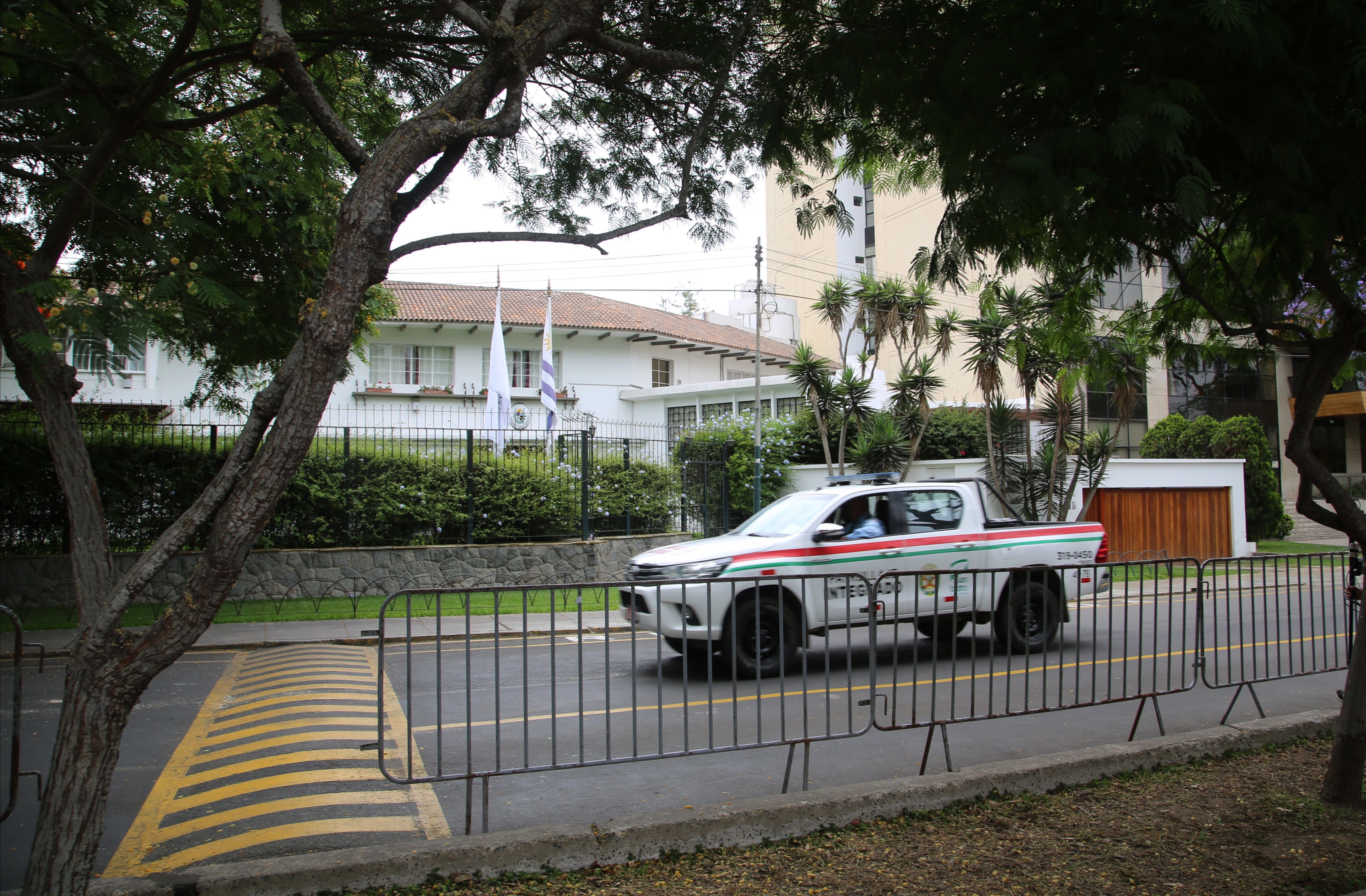 Barriers stand outside the residence of Uruguay's ambassador to Peru where Peru's former President Alan Garcia took refuge and asked for asylum, in Lima, Peru, Monday, Dec. 3, 2018. Garcia said Monday he would cooperate with prosecutors investigating him for corruption after Uruguay turned down his asylum request and forced him to leave the residence. (AP Photo/Mauricio Munoz)