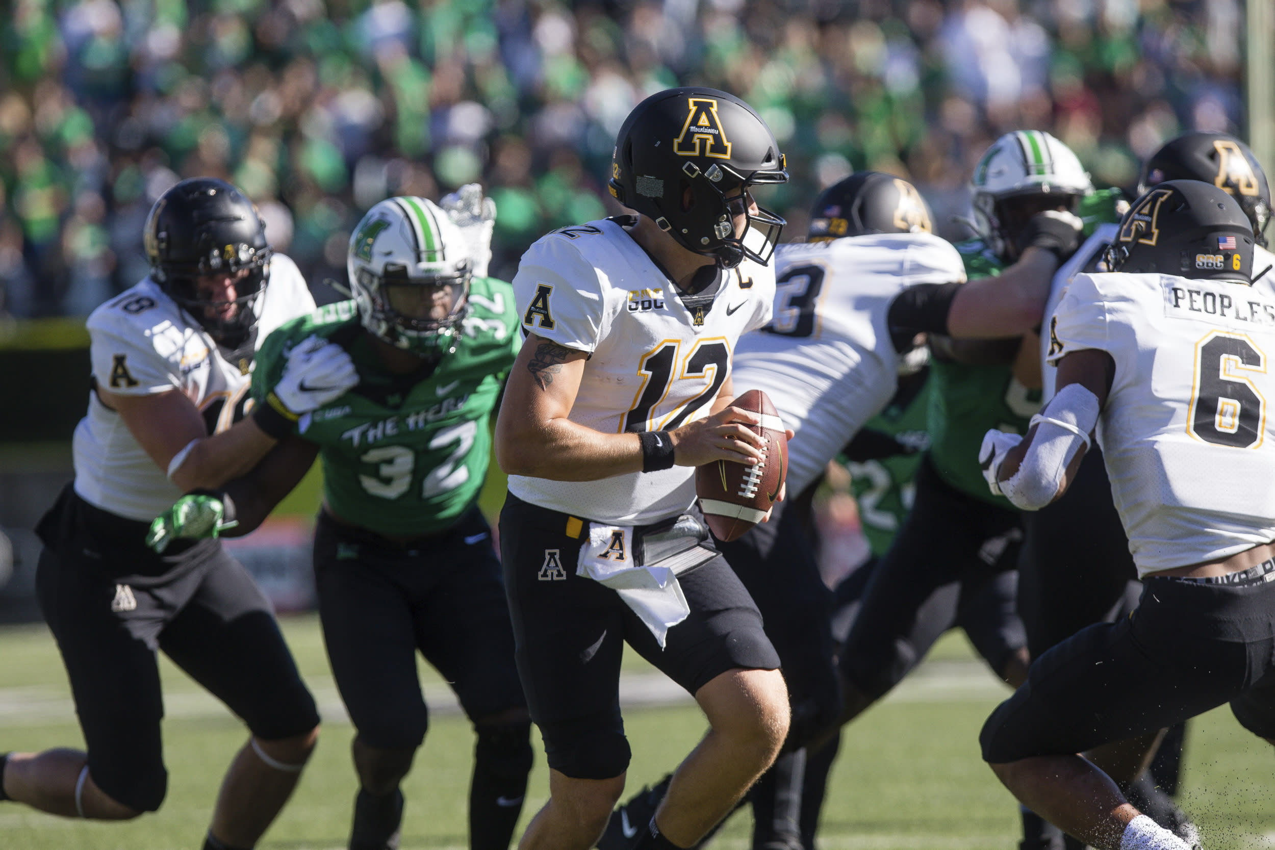 Appalachian State quarterback Zac Thomas (12) drops back to pass as they take on Marshall during an NCAA college football game Saturday, Sept. 19, 2020, in Huntington, W.Va. (Sholten Singer/The Herald-Dispatch via AP)