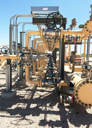 FILE PHOTO: Equipment used to process carbon dioxide, crude oil and water is seen at an Occidental Petroleum Corp enhanced oil recovery project in Hobbs, New Mexico, U.S. on May 3, 2017. Picture taken on May 3, 2017. REUTERS/Ernest Scheyder/File Photo
