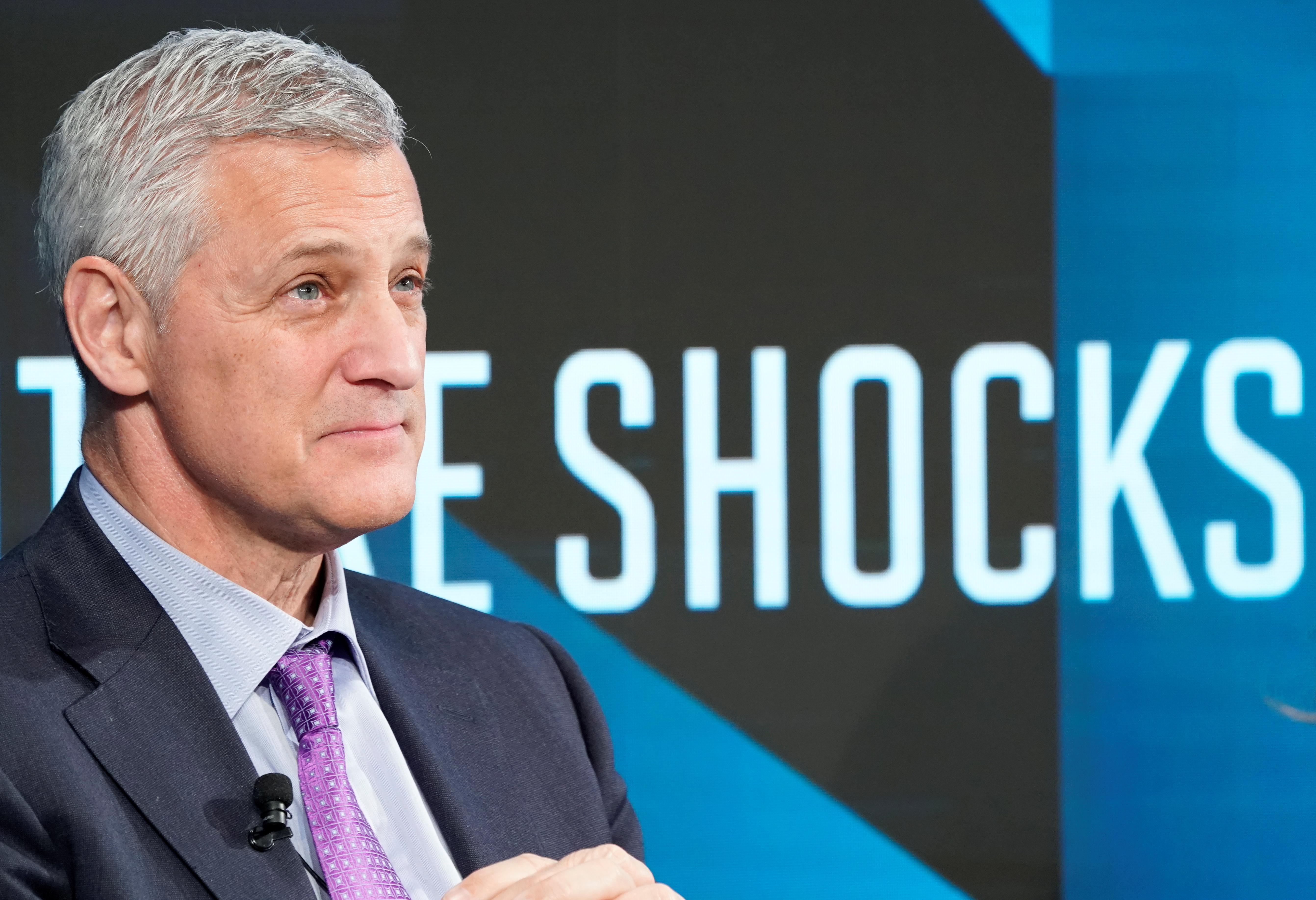 Bank CEO takes pay cut after investor rebellion