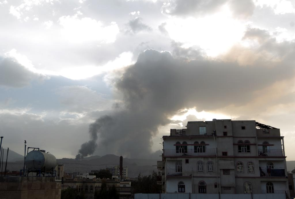 Smoke and flames rise allegedly from Shiite Huthi rebels camps located on Faj Attan Hill and Aser mountain following an airstrike by the Saudi-led alliance on April 6, 2015 in the Yemeni capital Sanaa