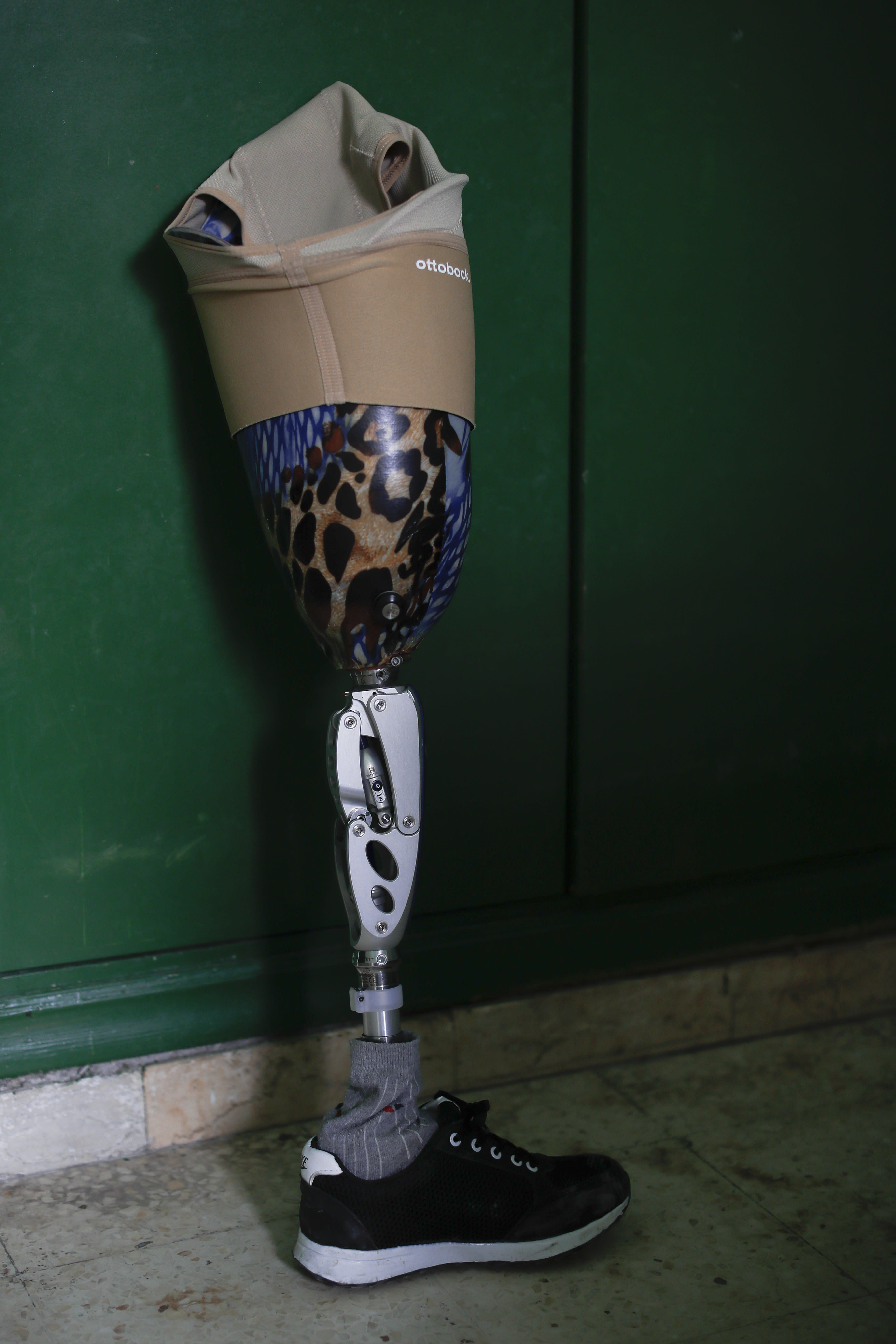 <p>A colorfully painted prosthetic leg — which belongs to a Syrian soldier who lost his leg while fighting in Syria's war — is seen propped against a wall at the Ahmad Hamish Martyr hospital in Damascus, Syria. (Photo: Hassan Ammar/AP) </p>