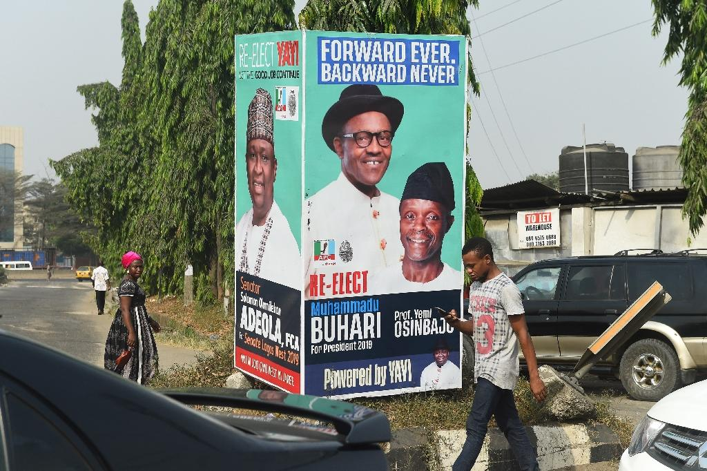 Election time: A campaign poster in Lagos for President Muhammadu Buhari and Vice President Yemi Osinbajo, contending next month's polls