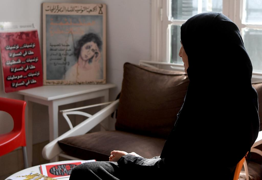 Sameh, a mother of two who suffered psychological abuse at the hand of her husband, speaks to a reporter in Tunis on February 20, 2018