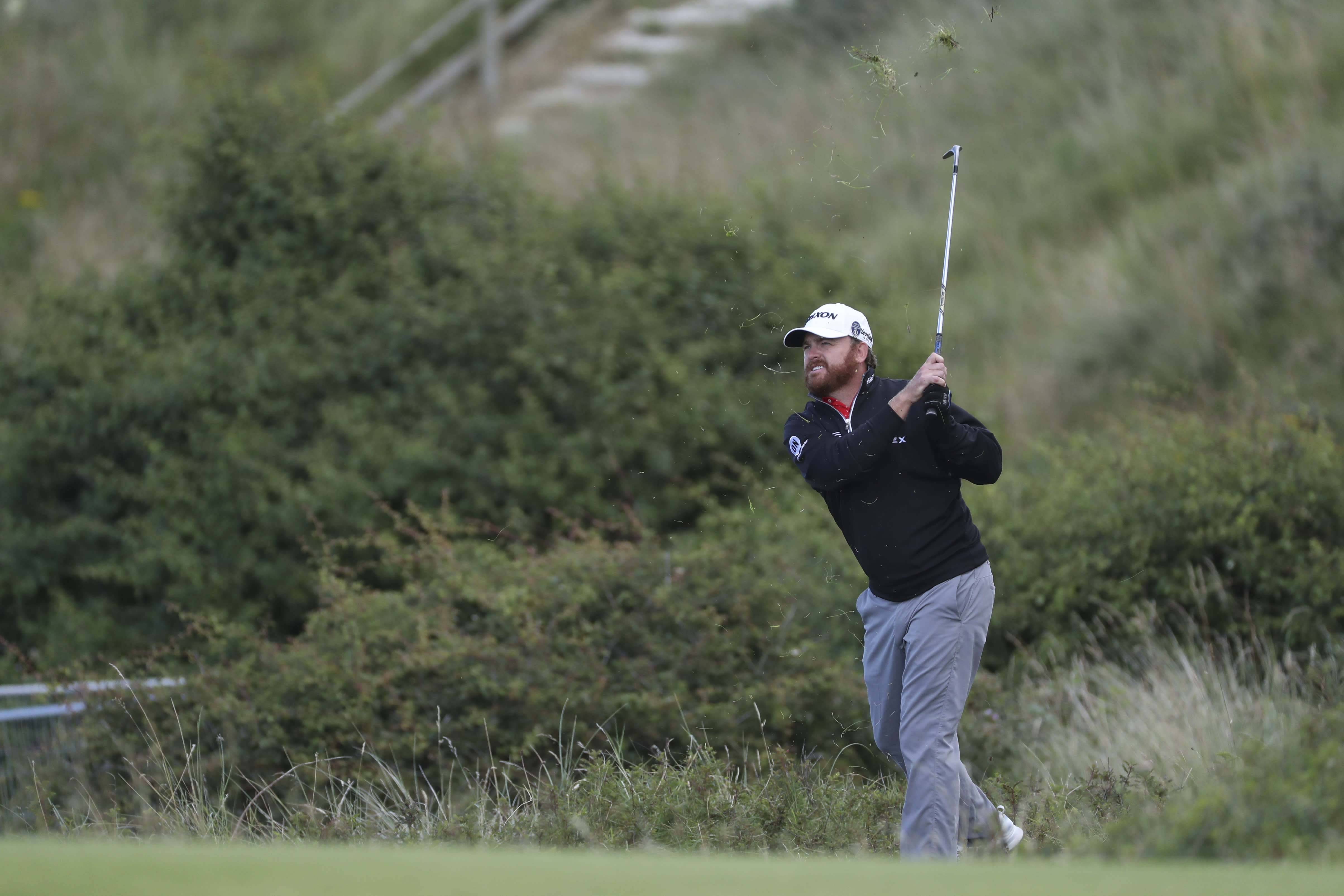 J.B. Holmes of the United States hits a shot on the 5th hole during the third round of the British Open Golf Championships at Royal Portrush in Northern Ireland, Saturday, July 20, 2019.(AP Photo/Peter Morrison)