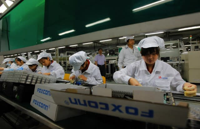 Foxconn resolves pay dispute that prompted mass suicide threat