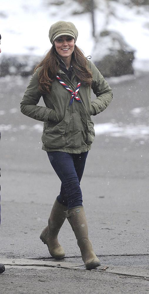 Kate visited the Great Tower Scout camp, keeping warm in green rain boots, a green army jacket and a knit crochet hat.
