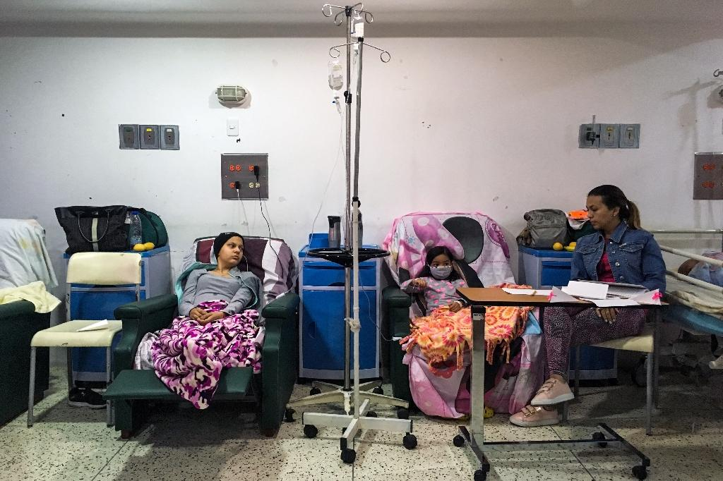 Chronic shortages of medicines as well as basic foodstuffs have been a wearying consequence of Venezuela's crippling years-long economic crisis (AFP Photo/FEDERICO PARRA)
