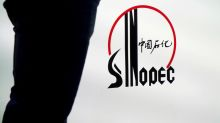 Sinopec's third-quarter profit drops a third on fuel glut, lower oil prices