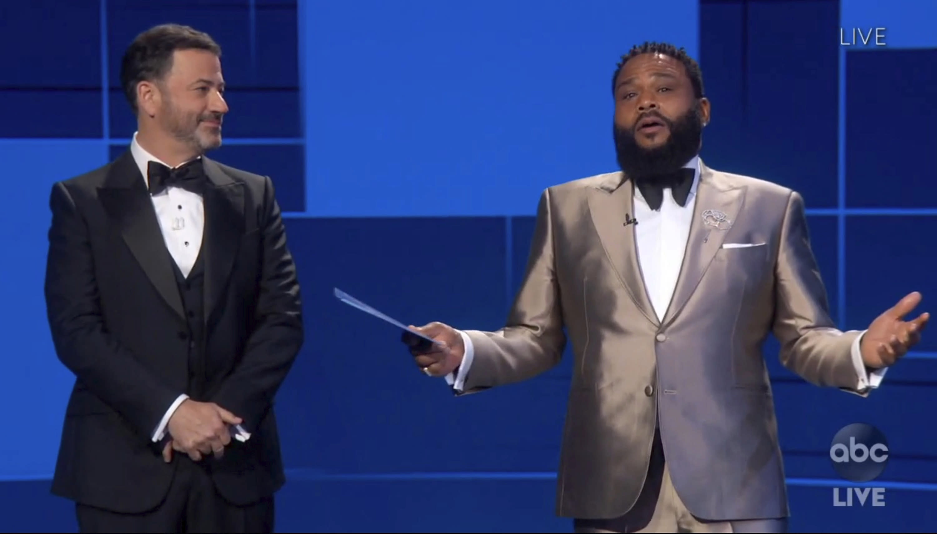 In this video grab captured on Sept. 20, 2020, courtesy of the Academy of Television Arts & Sciences and ABC Entertainment, Jimmy Kimmel, left, and Anthony Anderson speak on stage during the 72nd Emmy Awards broadcast. (The Television Academy and ABC Entertainment via AP)