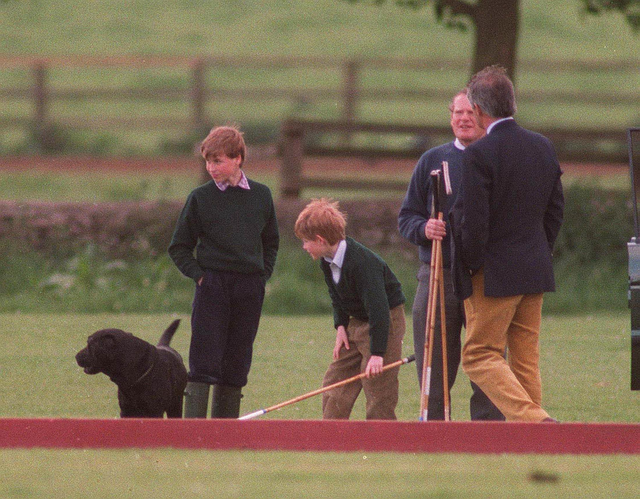 CIRENCESTER - MAY: (FILE PHOTO) Prince William and Prince Harry play around together at Cirencester Park polo club in May, 1995 in Cirencester, England.  (Photo by Anwar Hussein/Getty Images)
