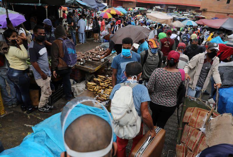 Customers walk at the Coche wholesale market amid coronavirus (COVID-19) disease outbreak in Caracas