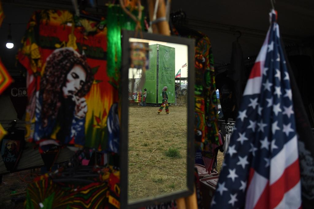 Bob Marley songs pumped out over stereos, vendors sold rolling papers and pipes, and the pungent whiff of marijuana filled the grounds (AFP Photo/Lillian SUWANRUMPHA)
