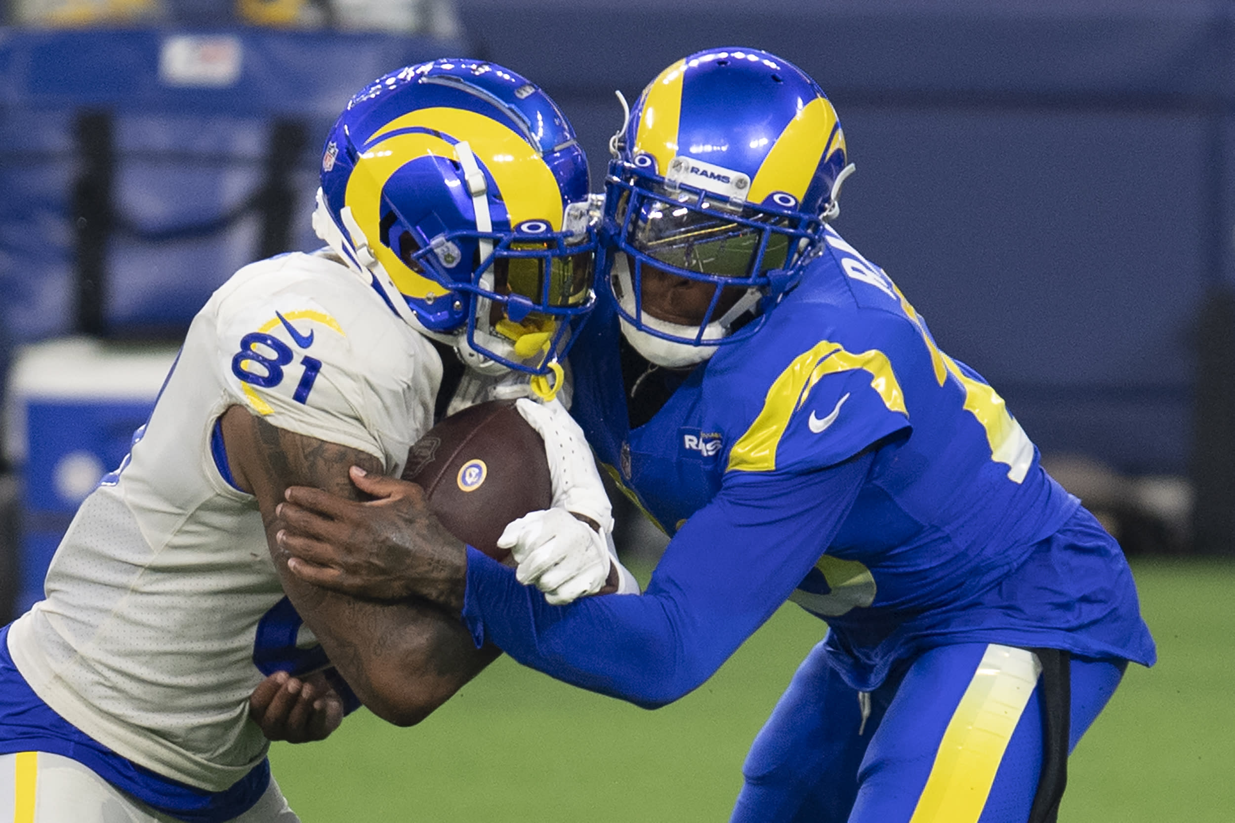 Los Angeles Rams cornerback Jalen Ramsey, right, tackles tight end Gerald Everett during NFL football practice Saturday, Aug. 22, 2020, in Inglewood, Calif. The Rams held their first practice at their new stadium. (AP Photo/Kyusung Gong)