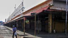 Esparcido desde un mercado, el coronavirus desborda una zona petrolera de Venezuela
