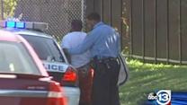 Adults get into altercation outside school