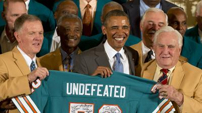 Obama Jokes With '72 Dolphins at White House